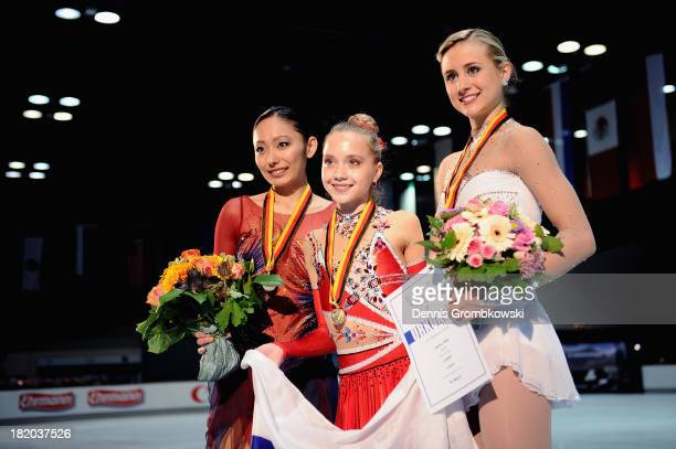 Miki Ando of Japan Elena Radionova of Russia and Ashley Cain of the United States pose after the Ladies competition during day two of the ISU...