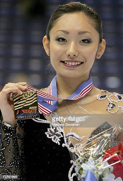 Miki Ando of Japan poses for photographers after the medal ceremony for the ladies competition during Skate America October 28 2006 at the Hartford...