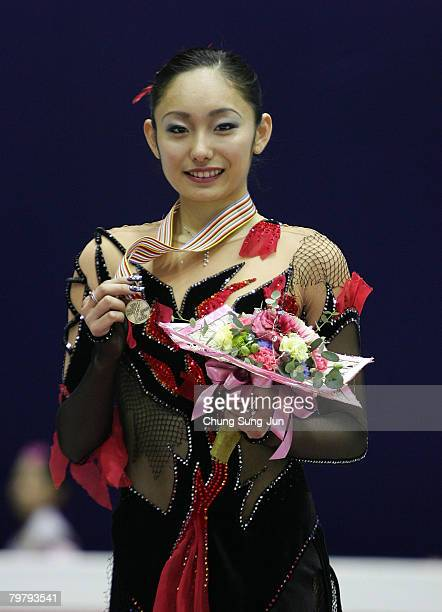 Miki Ando of Japan poses on the podium after winning the bronze medal in the Ladies Free skating for the International Skating Union Four Continents...