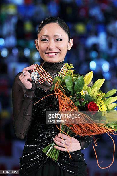 Miki Ando of Japan poses on the podium after winning the ladies's event of the ISU World Figure Skating Championships at Megasport Ice Rink on April...