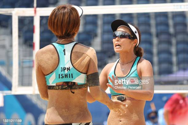 Miki Ishii of Team Japan and Megumi Murakami celebrate against Team Switzerland during the Women's Preliminary Round - Pool F beach volleyball on day...