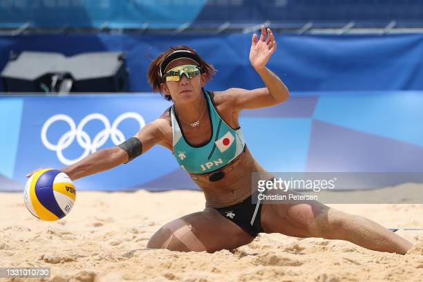 Miki Ishii of Team Japan attempts to hit against Team Switzerland during the Women's Preliminary Round - Pool F beach volleyball on day five of the...