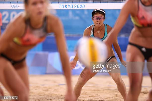 Miki Ishii of Team Japan competes against Team Germany during the Women's Preliminary - Pool F beach volleyball on day three of the Tokyo 2020...