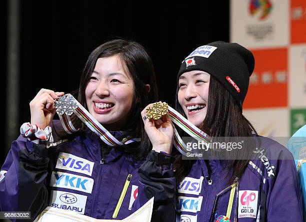 Miki Ito and Aiko Uemura of Japan pose for photographs during the Women's Dual Moguls medal ceremony of the FIS Freestyle World Championships at...