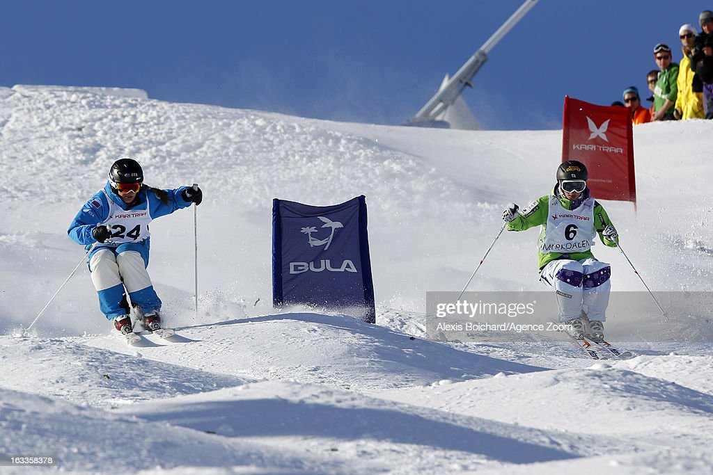 Miki Ito (R) of Japan and Elena Muratova of Russia compete during the FIS Freestyle Ski World Championship Men's and Women's Dual Moguls on March 08, 2013 in Voss, Norway.