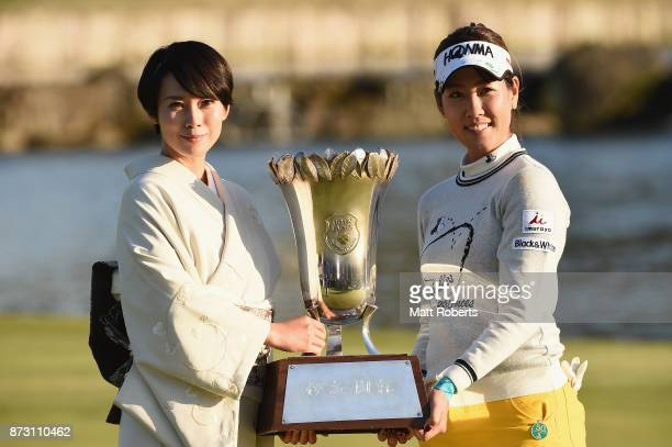 Miki Nakatani and Mami Fukuda pose during the trophy presentation after the final round of the Itoen Ladies Golf Tournament 2017 at the Great Island...