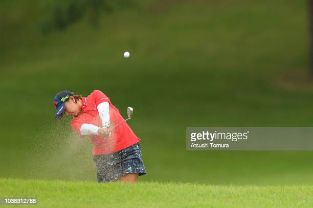 Miki Saeki of Japan hits from a bunker on the 17th hole during the final round of the Miyagi TV Cup Dunlop Ladies Open at Rifu Golf Club on September...