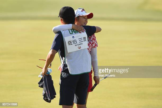 Miki Saiki of Japan hugs her caddie on the 18th green during the second round of the AXA Ladies Golf Tournament In Miyazaki at the UMK Country Club...