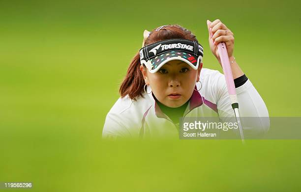Miki Saiki of Japan lines up a putt on the 13th green during the second round of the Evian Masters at the Evian Masters Golf Club on July 22 2011 in...
