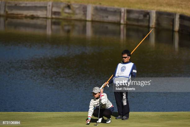 Miki Saiki of Japan prepares to putt on the 7th green during the final round of the Itoen Ladies Golf Tournament 2017 at the Great Island Club on...