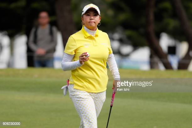 Miki Saiki of Japan reacts after her putt on the 10th hole during the second round of the Daikin Orchid Ladies at Ryukyu Golf Club on March 2 2018 in...