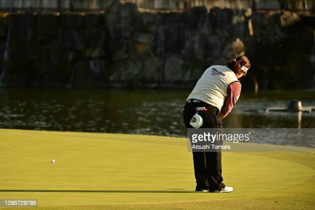 Miki Sakai of Japan attempts a putt on the 18th green on the play-off second hole following the final round of the Ito-En Ladies Golf Tournament at...