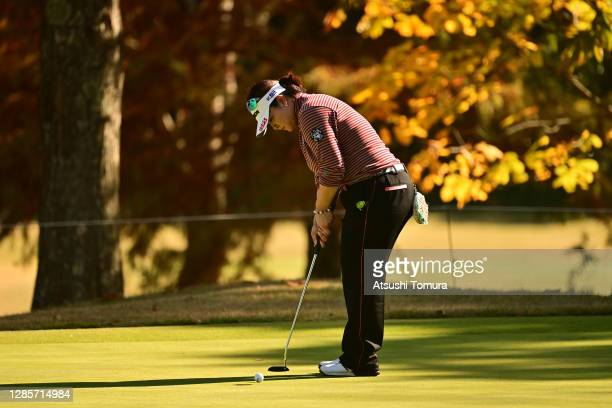 Miki Sakai of Japan attempts a putt on the 4th green during the final round of the Ito-En Ladies Golf Tournament at the Great Island Club on November...