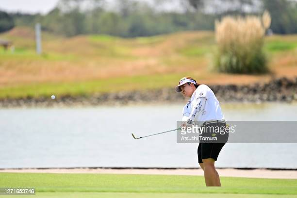 Miki Sakai of Japan chips onto the 9th green during the first round of the JLPGA Championship Konica Minolta Cup at the JFE Setonaikai Golf Club on...