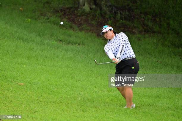 Miki Sakai of Japan hits her fourth shot on the 5th hole during the final round of the Descente Ladies Tokai Classic at the Shin Minami Aichi Country...