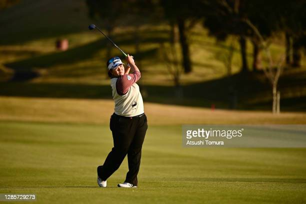 Miki Sakai of Japan hits her second shot on the 18th hole on the play-off second hole following the final round of the Ito-En Ladies Golf Tournament...