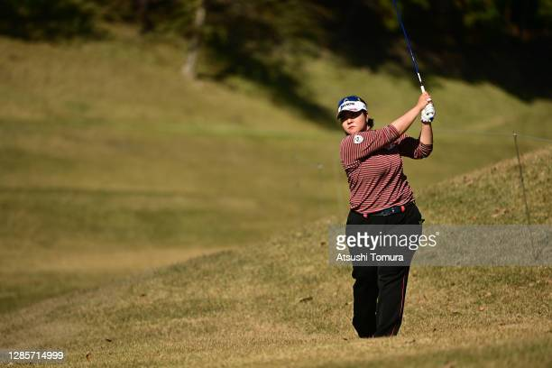 Miki Sakai of Japan hits her second shot on the 5th hole during the final round of the Ito-En Ladies Golf Tournament at the Great Island Club on...