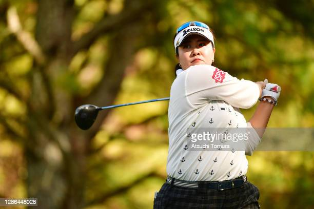 Miki Sakai of Japan hits her tee shot on the 13th hole during the first round of the Daio Paper Elleair Ladies Open at the Elleair Golf Club...