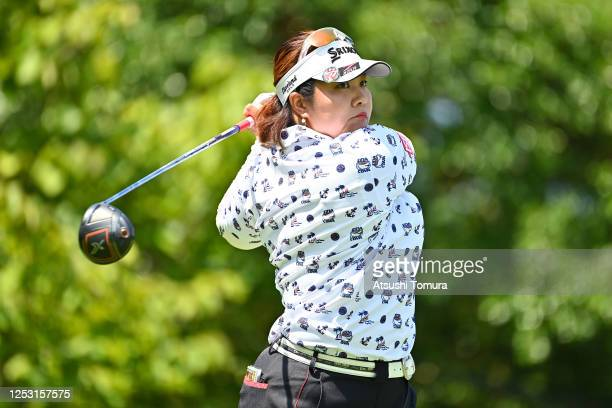 Miki Sakai of Japan hits her tee shot on the 1st hole during the final round of the Earth Mondamin Cup at the Camellia Hills Country Club on June 29...
