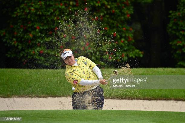 Miki Sakai of Japan hits out from a bunker on the 6th hole during the second round of the Earth Mondamin Cup at the Camellia Hills Country Club on...