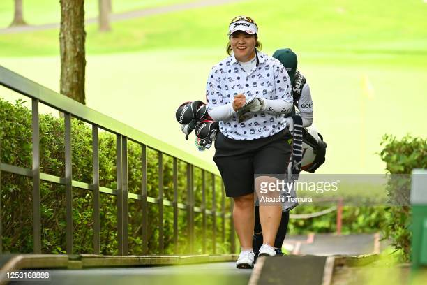 Miki Sakai of Japan is seen on her way to the 8th tee during the final round of the Earth Mondamin Cup at the Camellia Hills Country Club on June 29...