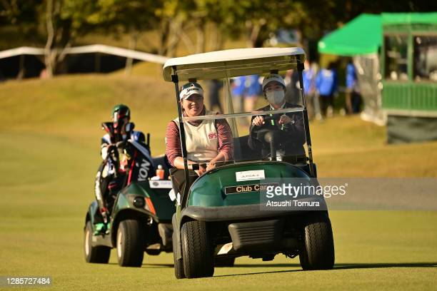 Miki Sakai of Japan is taken to the 18th tee for the play-off first hole during the final round of the Ito-En Ladies Golf Tournament at the Great...