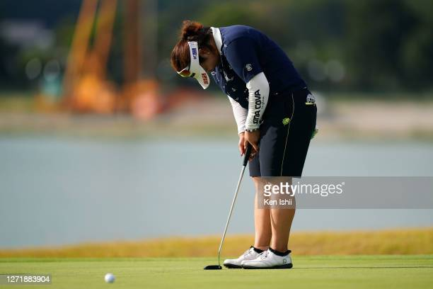 Miki Sakai of Japan shows dejection after missing the birdie putt on the 18th green during the second round of the JLPGA Championship Konica Minolta...