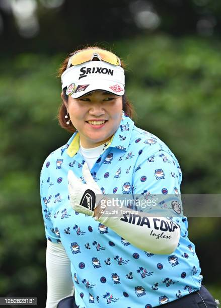 Miki Sakai of Japan smiles after her tee shot on the 14th hole during the third round of the Earth Mondamin Cup at the Camellia Hills Country Club on...