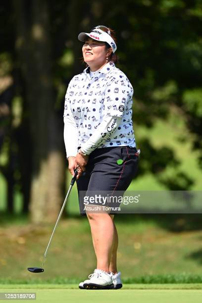 Miki Sakai of Japan smiles after holing out with the birdie on the 18th green during the final round of the Earth Mondamin Cup at the Camellia Hills...