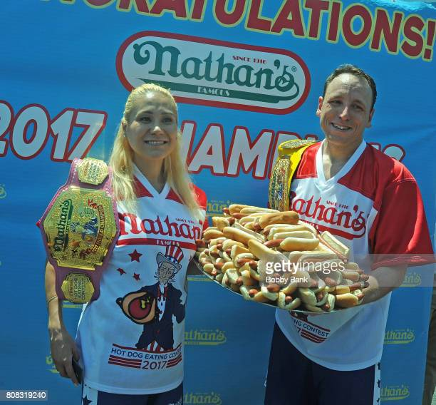 Miki Sudo and Joey Chestnut 2017 winners of the Nathans Famous 4th Of July International Hot Dog Eating Contest at Coney Island on July 4 2017 in the...