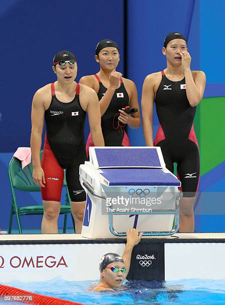 Miki Uchida Rikako Ikee Misaki Yamaguchi and Yayoi Matsumoto of Japan react after competing in the Women's 4x100m Freestyle Relay final on Day 1 of...