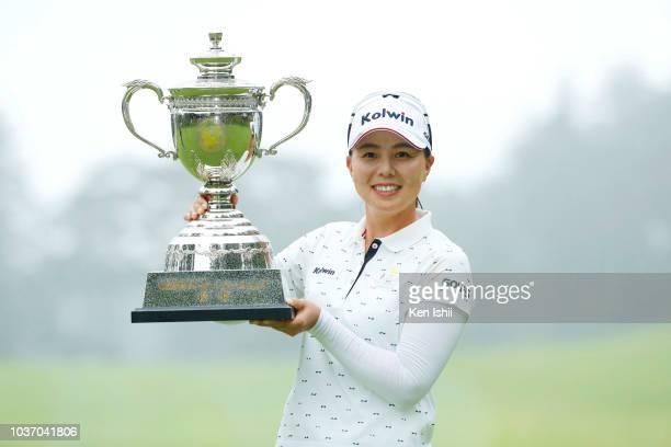 Miki Uehara of Japan celebrates on the 18th green after winning the Chugoku Shimbun Chupi Ladies at Geinan Country Club on September 21, 2018 in...