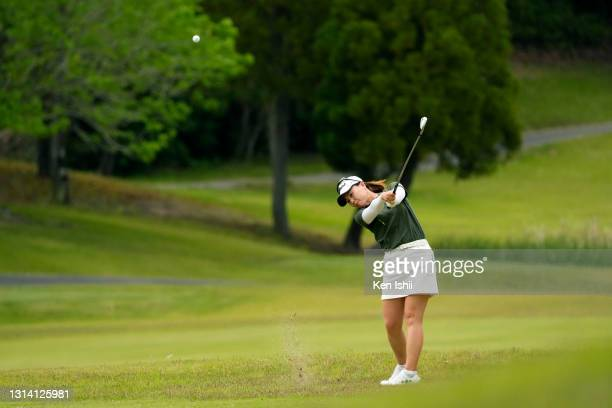 Miki Uehara of Japan hits her second shot on the 17th hole during the final round of the KCFG Ladies Madonoume Cup at the Takeo Golf Club on April...
