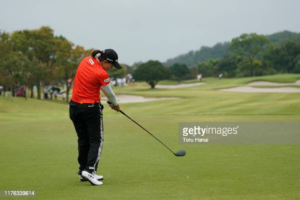 Miki Uehara of Japan hits her tee shot on the 8th hole during the final round of the Sanyo Shimbun Ladies Cup at Tojigaoka Marine Hills Golf Club on...