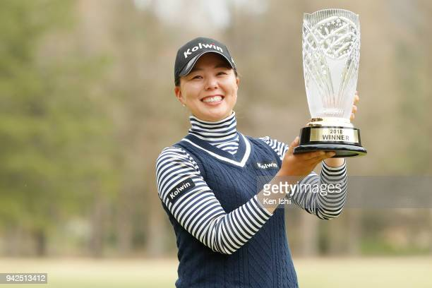 Miki Uehara of Japan holds a trophy after winning the Hanasaka Ladies Yanmar Golf Tournament at Biwako Country Club on April 6 2018 in Ritto Shiga...
