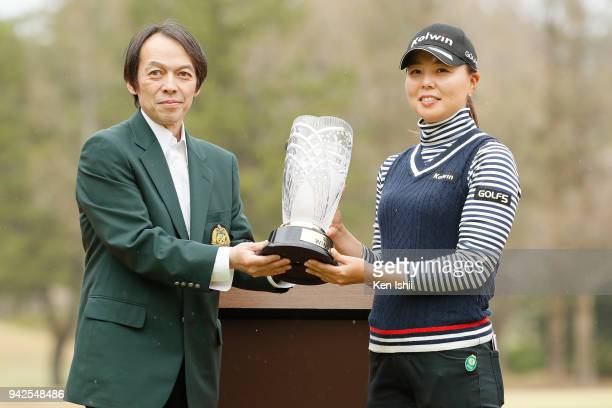 Miki Uehara of Japan holds a trophy with Takehito Yamaoka CEO at Yanmar Co after winning the Hanasaka Ladies Yanmar Golf Tournament at Biwako Country...