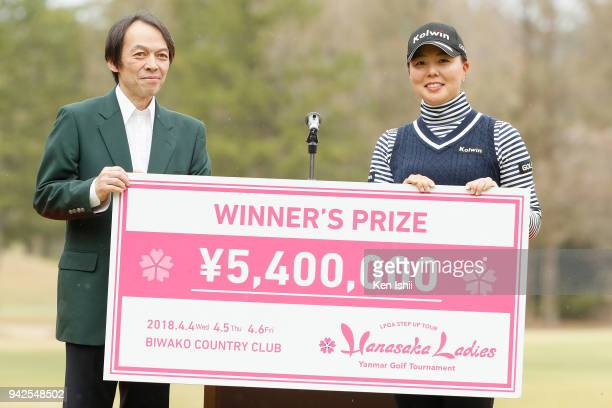 Miki Uehara of Japan holds the winner's check with Takehito Yamaoka CEO at Yanmar Co after winning the Hanasaka Ladies Yanmar Golf Tournament at...