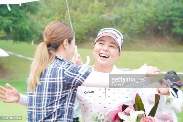 Miki Uehara of Japan hugs on the 18th green after winning the Chugoku Shimbun Chupi Ladies at Geinan Country Club on September 21, 2018 in...