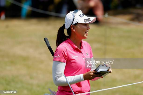 Miki Uehara of Japan smiles on the 18th green during the final round of the Sanin Godo Bank Duo Card Ladies at Daisen Heigen Golf Club on August 24,...