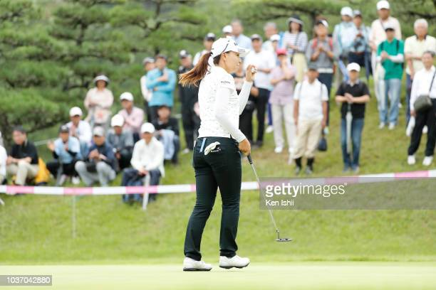 Miki Uehara of Japan waves to the gallery after her putt on the second hole during the final round of the Chugoku Shimbun Chupi Ladies at Geinan...