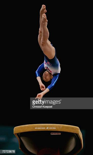 Miki Uemura of Japan competes in the Women's Vault final during the Artistic Gymnastics competition during the 15th Asian Games Doha 2006 at The...