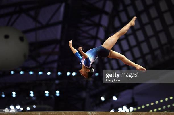 Miki Uemura of Japan competes on the balance beam during the Women's Individual AllAround Final at the 15th Asian Games Doha 2006 at Aspire Hall on...