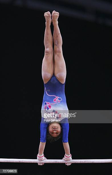 Miki Uemura of Japan competes on the uneven bars during the Women's Artistic Gymnastics Team Final and Individual Qualiification at the 15th Asian...