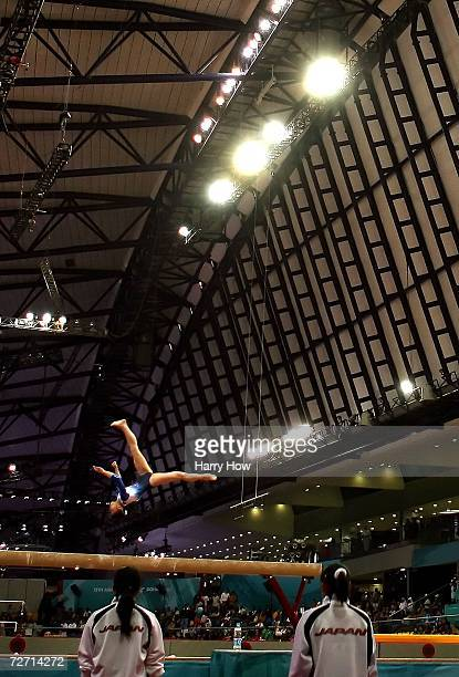 Miki Uemura of Japan is watched by her team mates as she competes on the balance beam during the Women's Individual AllAround Final at the 15th Asian...
