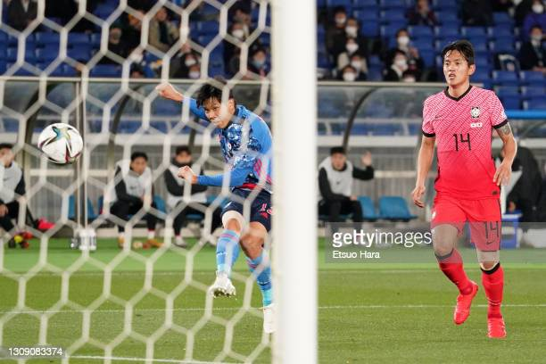 Miki Yamane of Japan scores his side's first goal during the international friendly match between Japan and South Korea at the Nissan Stadium on...