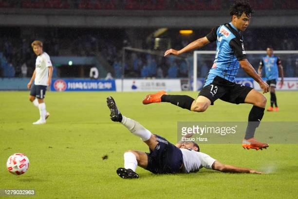 Miki Yamane of Kawasaki Frontale and Diego Oliveira of FC Tokyo compete for the ball during the J.League YBC Levain Cup semi-final match between...