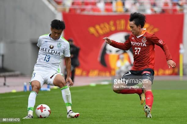 Miki Yamane of Shonan Bellmare and Koki Sugimori of Nagoya Grampus compete for the ball during the J.League J2 match between Nagoya Grampus and...