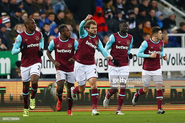 Mikica Jelavic of West Ham United celebrates scoring his team's first goal with his team mates during the Barclays Premier League match between...