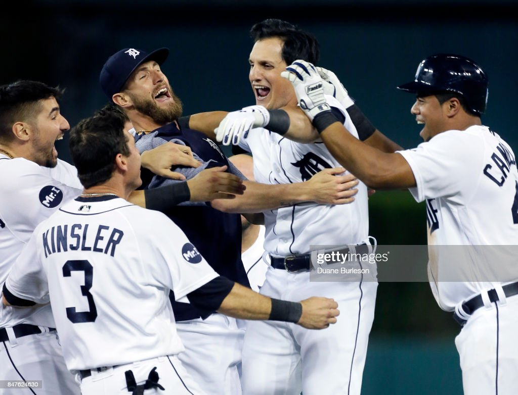 Mikie Mahtook #15 of the Detroit Tigers celebrates with Nicholas Castellanos #9 of the Detroit Tigers, Ian Kinsler #3 of the Detroit Tigers, Shane Greene #61 of the Detroit Tigers and Jeimer Candelario #46 of the Detroit Tigers after hitting a walk-off single in the ninth inning to drive in Candelario and defeat the Chicago White Sox 3-2 at Comerica Park on September 15, 2017 in Detroit, Michigan.