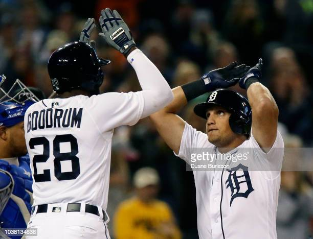 Mikie Mahtook of the Detroit Tigers celebrates with Niko Goodrum of the Detroit Tigers after hitting a tworun home run against the Kansas City Royals...